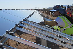 Worker installs panels at Paloma plant